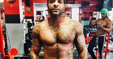 Jim Jones Muscles Up from Grinding in Gym